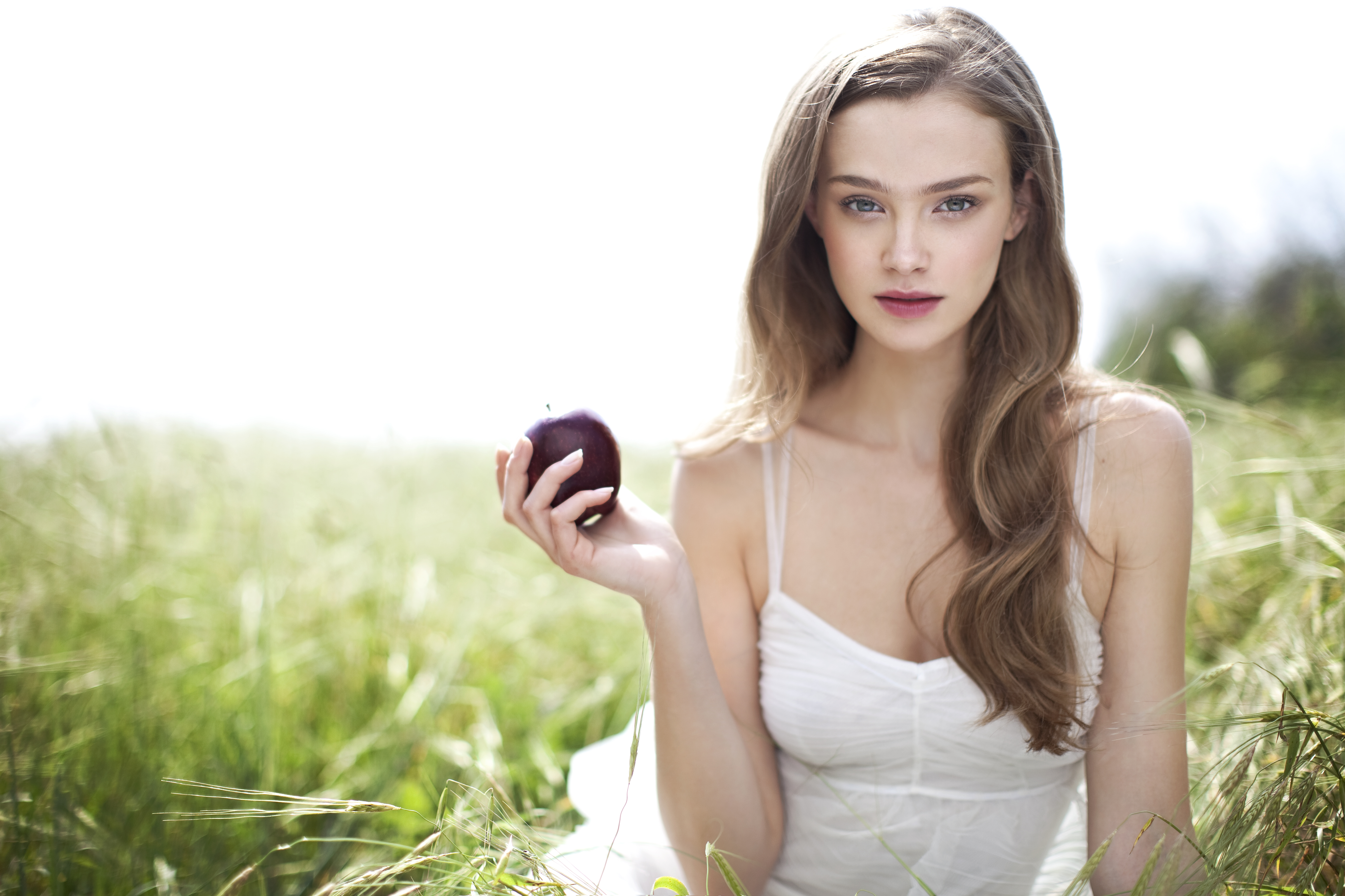Adore cosmetics model with apple